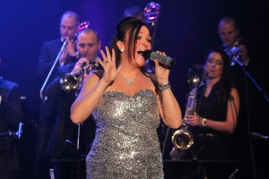 Kerry Schultz takes center stage for many of Q The Music Show's numbers
