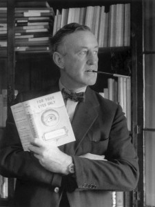 Ian Fleming holds a copy of his short story collection, For Your Eyes Only
