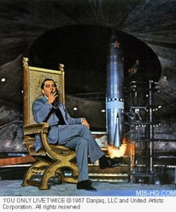 Ken Adam poses on his You Only Live Twice volcano set, 1967