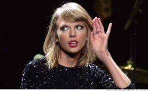 Evil Taylor Swift listens for Bond in hopes of retrieving her album.